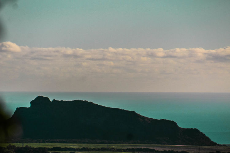 Mountain in the shape of a man lying Beauty In Nature Day Horizon Over Water Landscape Mountain Nature No People Outdoors Scenics Sea Sky Tranquil Scene Tranquility Water