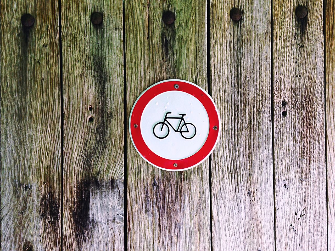 Close-Up Of Information Sign On Wooden Planks