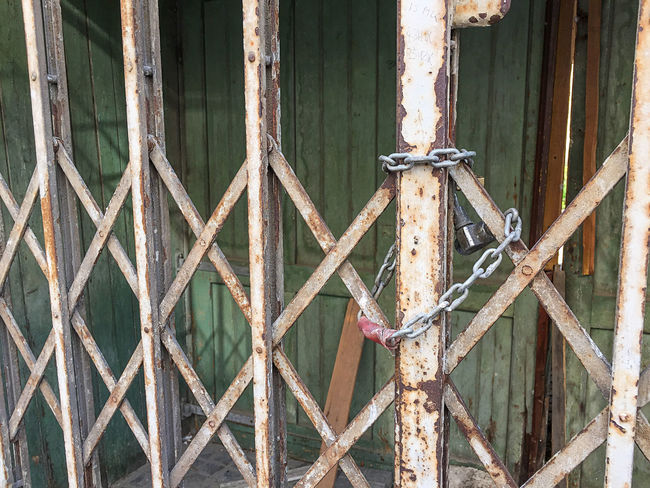 old door locked with a chain and a padlock Locked Abandoned Chain Close-up Day Door Lock Metal No People Outdoors Padlock Padock Prison Protection Rusty Safety Security Security System Wood - Material