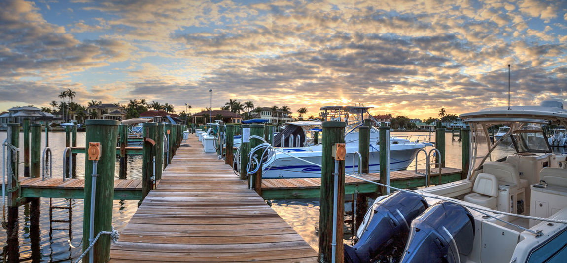 Harbor with boats at golden hour as day breaks over the North Gulf Shore Harbor at sunrise in Naples Florida. Water Cloud - Sky Sky Sunset Nature No People Outdoors Boat Ship Sunrise Daybreak Dawn Venetian Bay Florida Harbor Landscape Panoramic Panorama View Waterfront Coastline Coastal Clouds And Skies Golden Hour