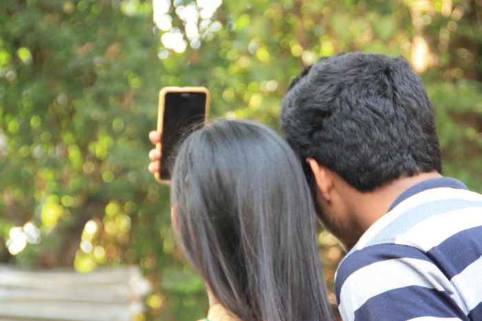 Two People Heterosexual Couple Togetherness Love Headshot Bonding Young Adult Couple - Relationship Adults Only Young Men Young Couple Affectionate Casual Clothing Communication Young Women Romance Adult Men People Rear View Mobile Conversations