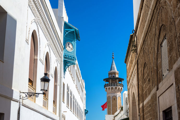 View of the medina in Tunis, Tunisia with the minaret of Hammouda Pacha Mosque and blue sky Tunisia Tunis Tunisie Africa North North Africa Arab Building Blue Day No People Clear Sky Architecture Building Exterior Built Structure Sky Medina Tunisian Mosque Hammouda Pacha Hammouda Pacha Mosque Turkish Clock Minaret Place Of Worship