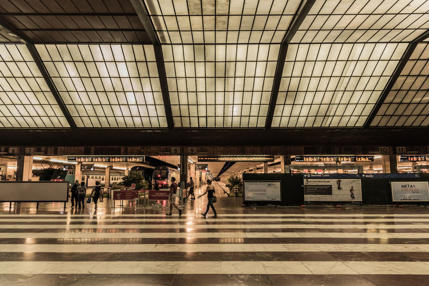 Adult Architecture Ceiling Day Full Length Group Of People Illuminated Indoors  Large Group Of People Lifestyles Men Passenger People Public Transportation Railroad Station Railroad Station Platform Real People Standing Technology Transportation Travel Waiting Women