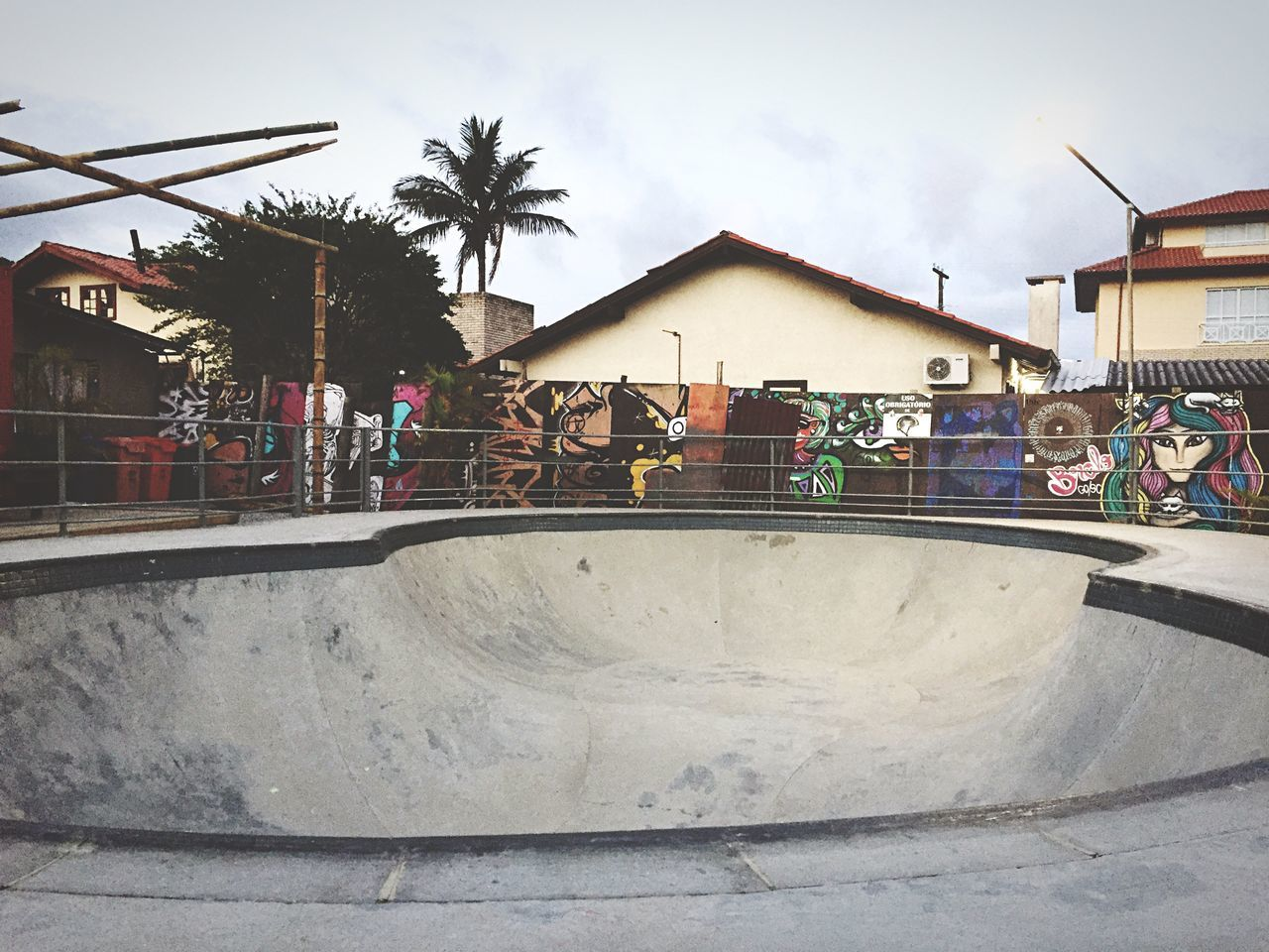 built structure, building exterior, skateboard park, architecture, skateboard, real people, sports ramp, palm tree, skill, sky, day, men, outdoors, large group of people, extreme sports, people