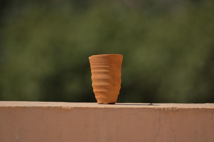 Cup made of mud sand called kulhad kullhad used to serve authentic indian drinks structure on wall