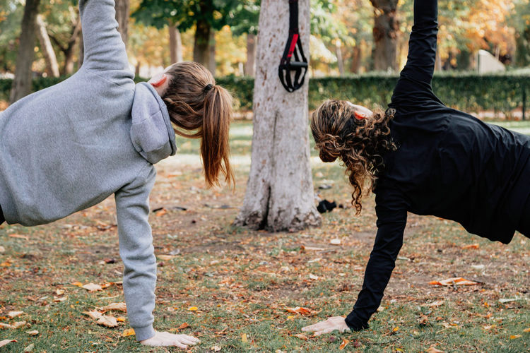 Mid adult women exercising at park