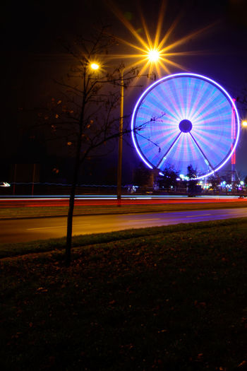 Amusement Park City Ferris Wheel Illuminated Multi Colored Night No People Outdoors