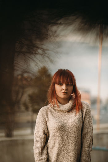 Redhead One Person Young Adult Sweater Adult Portrait Beautiful Woman Beauty Clothing Hairstyle Hair Sky Focus On Foreground Contemplation Front View Nature Turtleneck Warm Clothing Bangs Scarf Dyed Red Hair