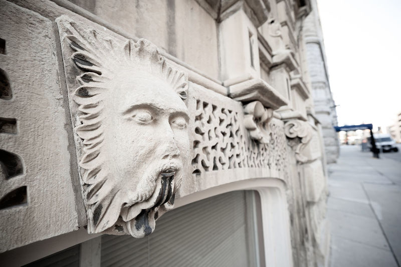 Close-up of sculpture against building