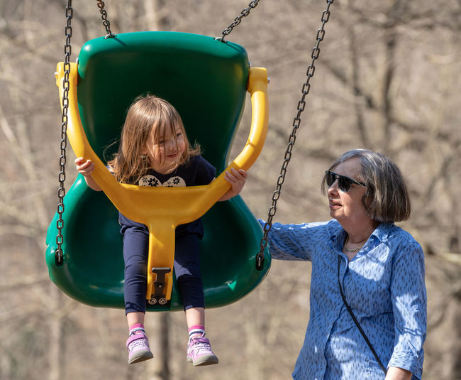 Girl with grandmother on swing
