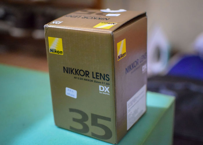Taking a pic of a Nikkor 35mm lens with a Nikkor 35mm lens Camera Lens Nikon Nikkor Nikkor 35mm 1:1.8 Nikon Lens Prime Lens Product Photography Product Shot