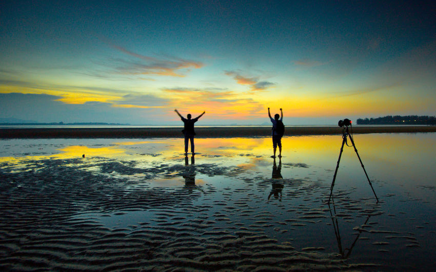 man during wondeful sunset Beauty In Nature Cloud - Sky Day Full Length Leisure Activity Lifestyles Men Nature Outdoors People Real People Reflection Scenics Sea Silhouette Sky Standing Sunset Togetherness Tranquil Scene Tranquility Water Women