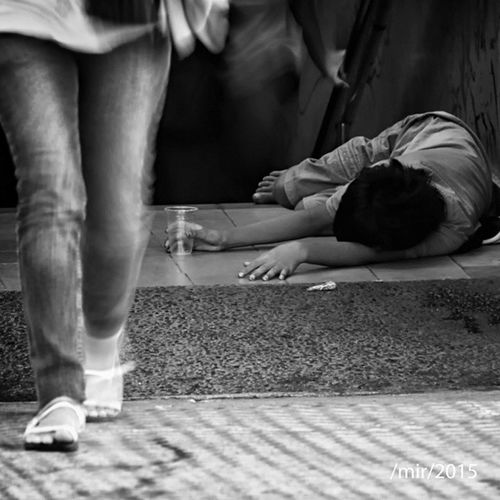 .: an empty glass :. a street kid laying on pavements with an empty glass on his palm. there are thousands street children in Jakarta, most of them work as beggars, street singers, windshield cleaners, street sellers. Streetphotography Blackandwhite Bnw Street_children beggar streetphoto simply_noir_blanc bw_indonesia monochrome dailyphoto street_life insta_bw candid documentary bnw_magazine