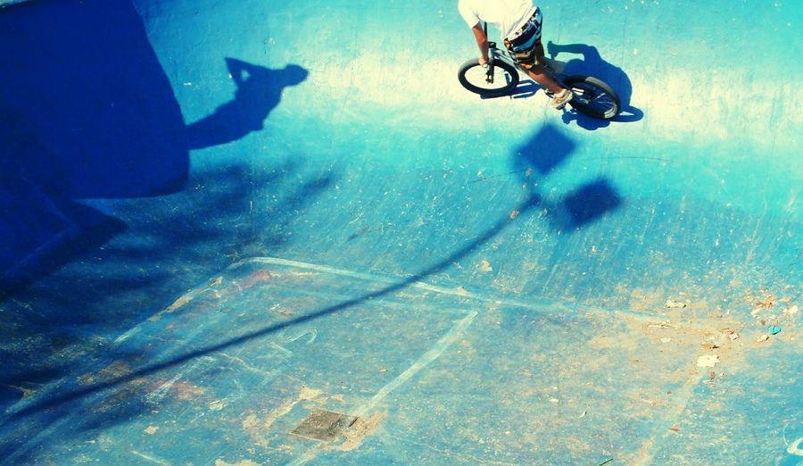 High angle view of man cycling at skateboard park