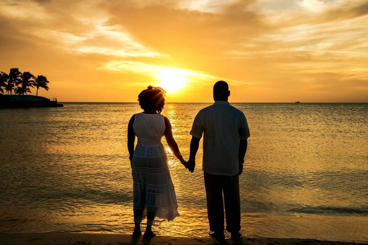 Sunset Two People Love Togetherness Silhouette Orange Color Tranquil Scene Sunset Sea Water Sky Beach Beauty In Nature Scenics Real People Standing Rear View EyeEm Nature Lover EyeEm Best Shots Turks And Caicos Sand Holding Hands Forever Inlove Honeymoon Portrait Photography