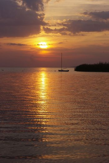 Beauty In Nature Calm Horizon Over Water Idyllic Nature Outdoors Sunset Tranquil Scene Vibrant Color Water