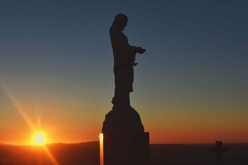 Risen over the World Jesus Christ Sunset Sky Silhouette Statue Sculpture Human Representation Representation