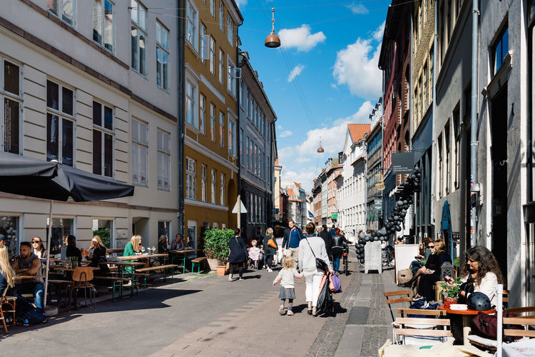 Commercial street in Copenhagen Architecture Building Exterior Built Structure Cat City Commercial Crowd Day Destination Large Group Of People Outdoors Pedestrian People Retail  Scandinavia Scandinavian Sidewalk Cafe Sitting Sky Street Strøget Tranquility Travel Travel Destinations