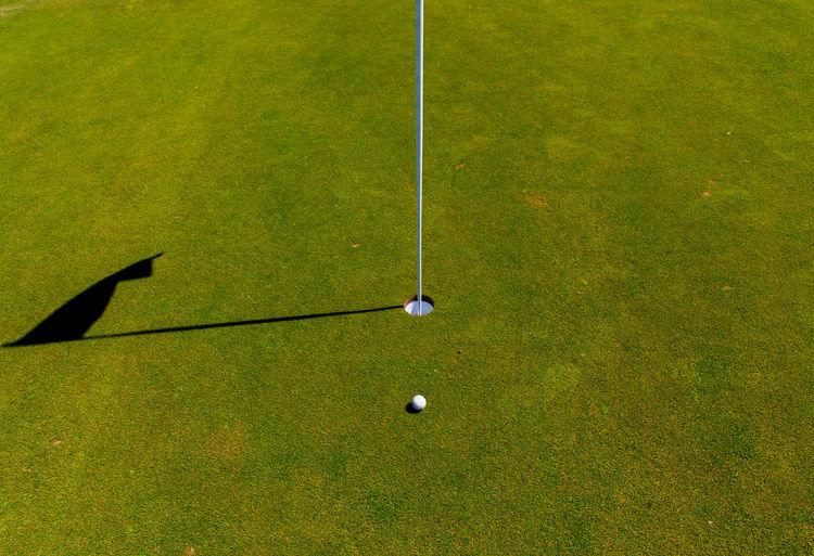 High angle view of golf ball on floor