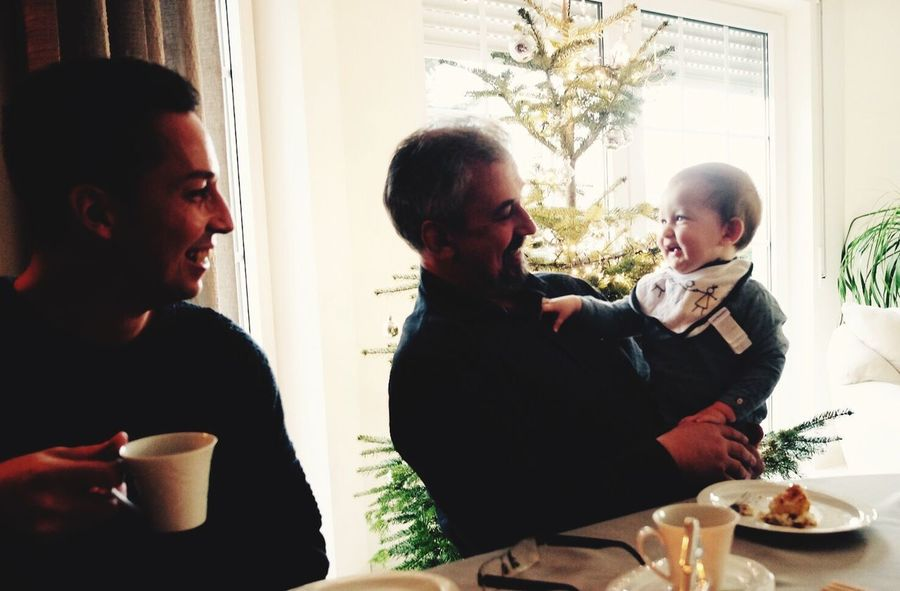 3 generations. Indoors  Table Happiness Grandpa Baby Generations Grandfather Boy Babyboy Family Christmas Tree Family❤ Family Time Man Christmas Lights Christmas Decoration Smile Love