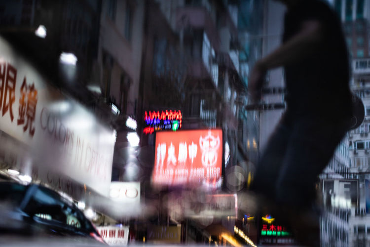 Blurred motion of bus sign in city