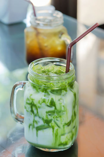 Close-up Container Drink Focus On Foreground Food Food And Drink Freshness Glass Glass - Material Green Color Healthy Eating Herb Indoors  Jar Mint Leaf - Culinary No People Refreshment Still Life Table Transparent Vegetable Wellbeing