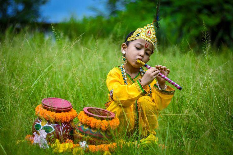 Little boy dressed as lord krishna.