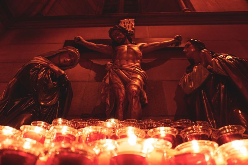 Belief Low Angle View Indoors  Religion Fire Statue Burning Sculpture Spirituality Male Likeness Place Of Worship Representation Flame