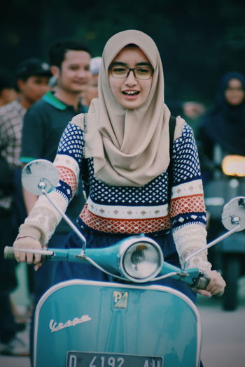 Schooter girl.. Adult Young Women Young Adult Adults Only People Togetherness Three People Casual Clothing Women Front View Holding Only Women Young Men Day Outdoors Portrait Standing Smiling Men Friendship The Portraitist - 2017 EyeEm Awards One Person Moods Vespa Indonesia Vespavintage The Portraitist - 2017 EyeEm Awards