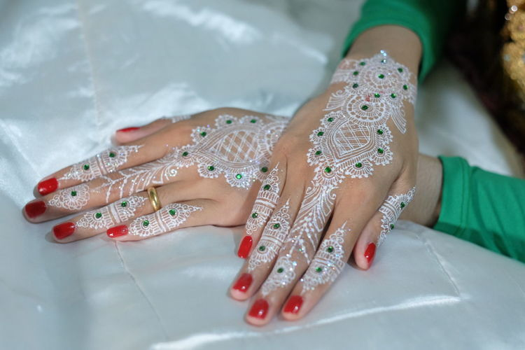 Close-up of hand with heena tattoo