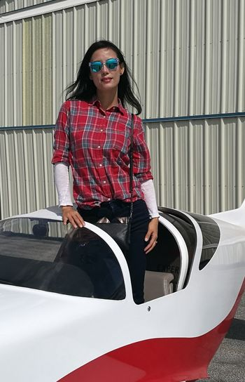 Woman egress from airplane Sunglasses One Woman Only Red One Young Woman Only Beautiful Woman Black Hair Airplane EyeEm Selects EyeEmNewHere