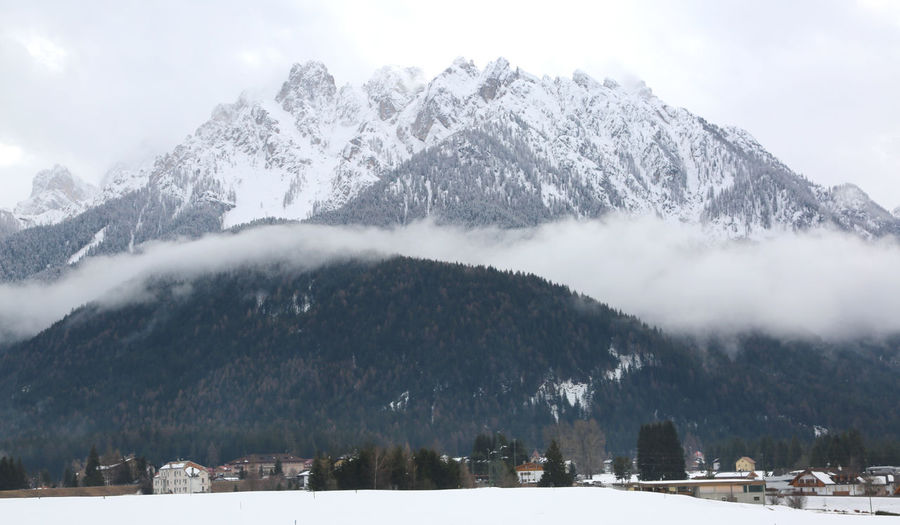 great mountains with snow near the Toblach Town in northern Italy in the South Tyrol Toblach Dobbiaco South Tyrol Italy Italian Bolzano Puster Valley Country Land Landscape Scenery Panorama View Scenes Mist Haze Fog Steam Fog Steam Mistiness Mountain Mount Mountains Winter Snow Snowy Snowed Cold Chilly Cool Tyrol