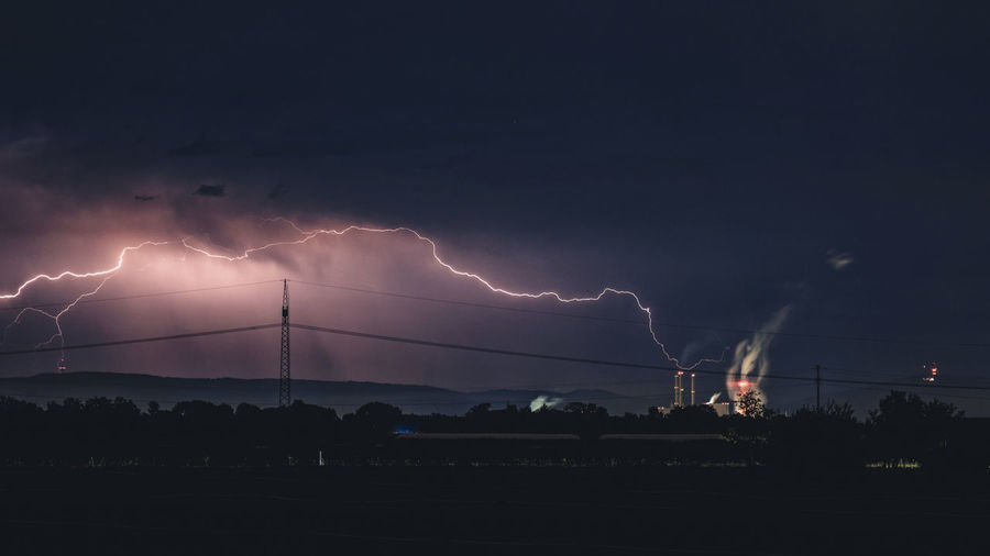 Blitze über dem Kraftwerk Beauty In Nature Cloud - Sky Dark Electricity  Environment Extreme Weather Forked Lightning Landscape Lightning Nature Night No People Outdoors Power Power In Nature Power Supply Scenics - Nature Sign Sky Storm Storm Cloud Thunderstorm Warning Sign