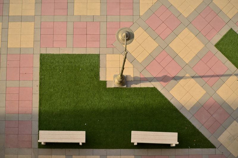 High angle view of tiled floor in lawn