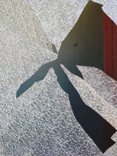 High angle view of shadow on concrete wall