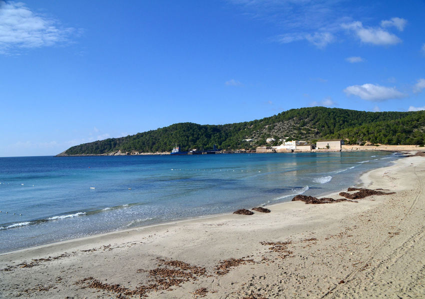 Ses Salines beach in Ibiza, Spain Balearic Islands Beach Blue Coastline Ibiza Island Islas Baleares Mediterranean  Mountain Nature Ocean Outdoors Picturesque Sand Scenics Sea Sea View Seaside Ses Salines Sightseeing Summer Tourism Tranquil Scene Travel Water
