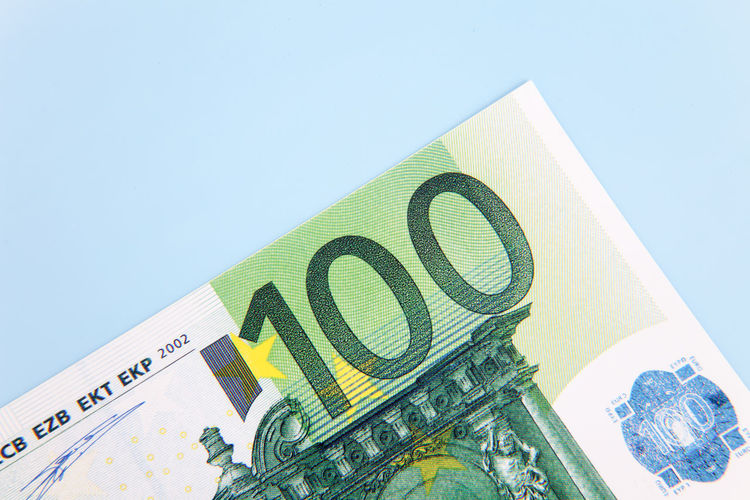 Hundred euro note on light blue background Banking Bonus Credit Currency Debit Euro Notes Euro Zone Financial Financial Planning Financial Service Make Money Money Money Money Money Premium Save Money Savings