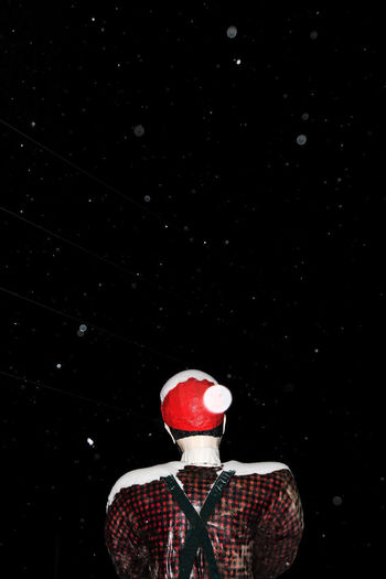 Christmas Travel Black Background Clown Men Night One Person Outdoors People Real People Red Snow Studio Shot