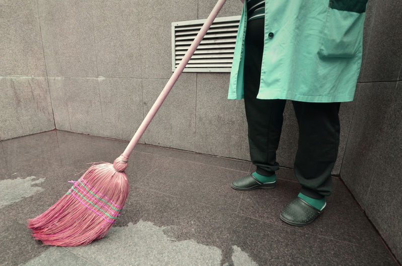 Person with broom