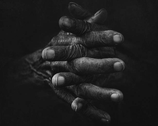Hand and all makes memories Hand Old Oldhand Lowlight Lowkey  Lowkeyphotography Lowkey_B&W One Person Human Body Part Human Hand Close-up Body Part Black Background Selective Focus Men Studio Shot Indoors  Real People Focus On Foreground First Eyeem Photo
