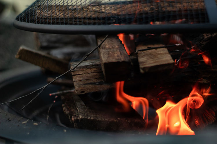 Close-Up Of Wood Burning In Fire Pit