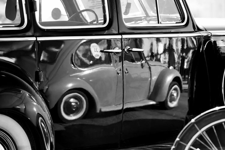 Close-Up Of Vintage Car With Reflection