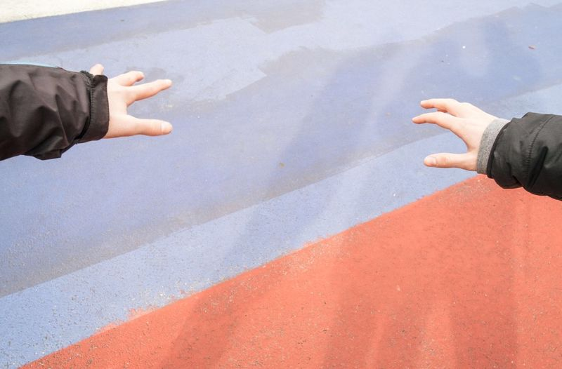 High angle view of people hand on street
