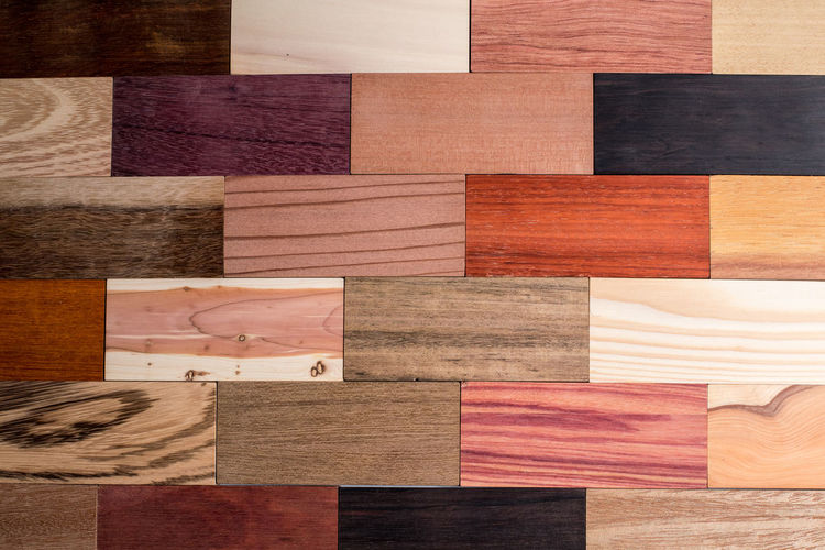 High angle view of multi colored pencils on hardwood floor