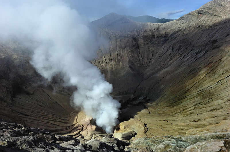 High Angle View Of Smoke Emitting From Volcanic Crater