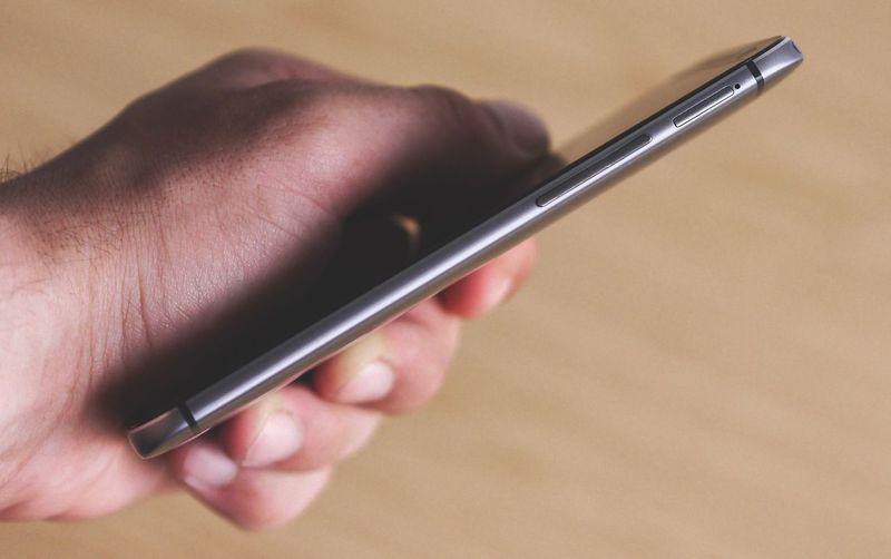 Close-up of person using mobile phone