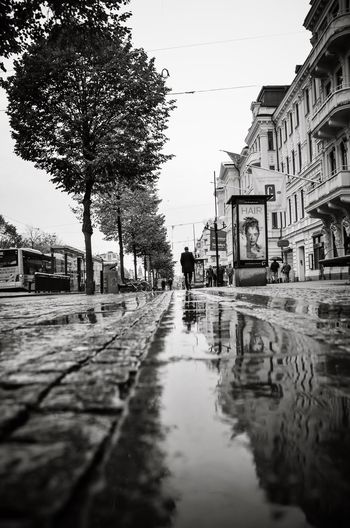 Adapted To The City Street Reflection Wet Rain Building Exterior Walking The Way Forward One Person Rainy Season Architecture B&w Street Photography B&w Göteborg, Sweden Sweden Outdoors