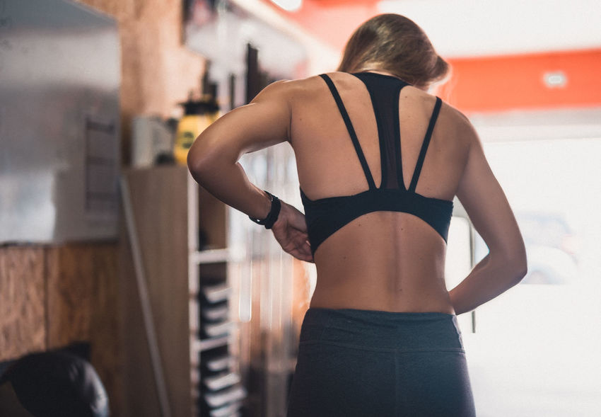 Exercising Indoor Activities Musculation  Squat Before Competition Before Workout Blonde Exercising Cross Training Crossfit Crossfit Girl Energy Gym Kettlebell  Lifestyles Muscular Build One Person Real People Rear View Sport Sport Clothing Sports Clothing Stretching Training Weightlifting Workout