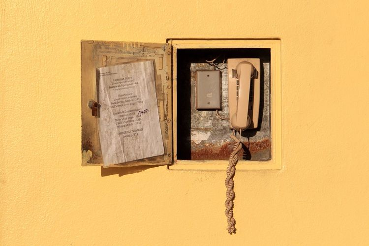 You've got a call. | @Lostboymemoirs Communication Primary Colors Phone California Santa Cruz Vintage Colorful Yellow Wall - Building Feature No People Built Structure Architecture Close-up Pattern Frame Building Exterior Damaged Communication Orange Color