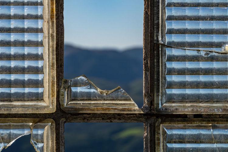 Close-up of broken window